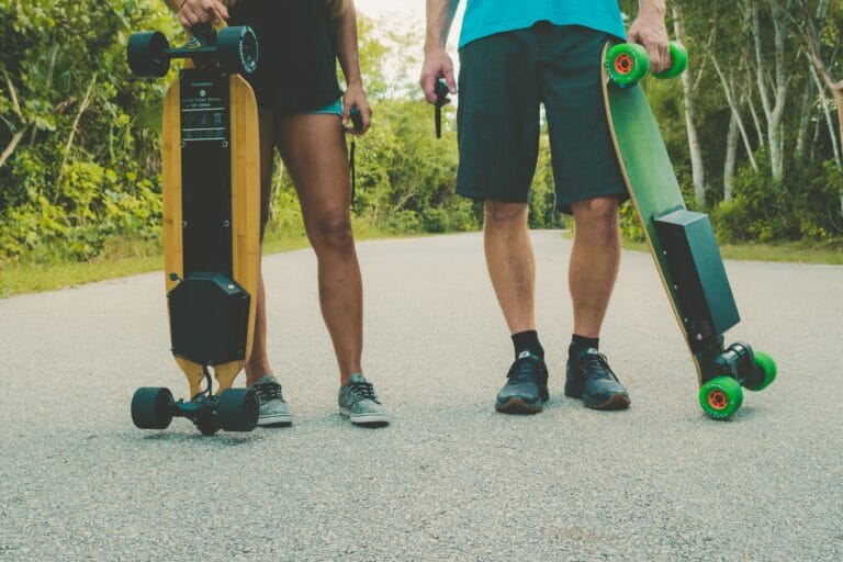 riders with electric skateboards