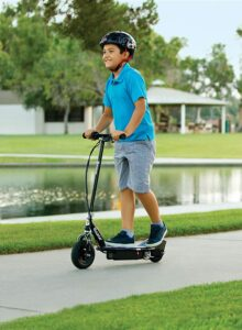 Razor E100 Glow Electric Scooter for Kids - kid riding the scooter