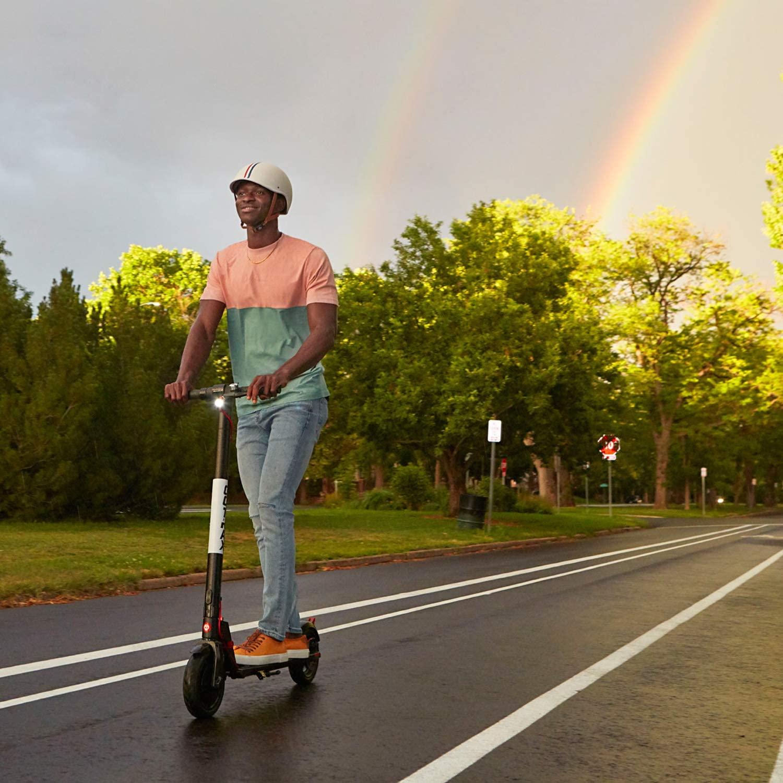 boy riding a Gotrax scooter