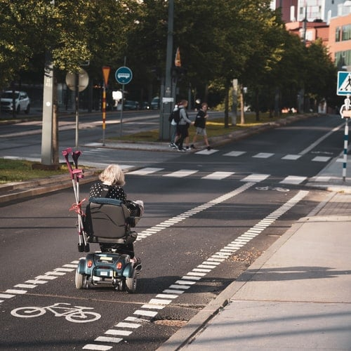an old lady riding a mobility scooter