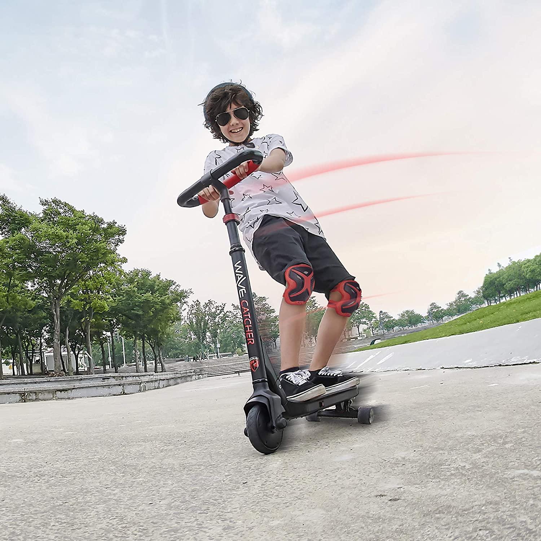 boy riding Wave Catcher three-wheel scooter