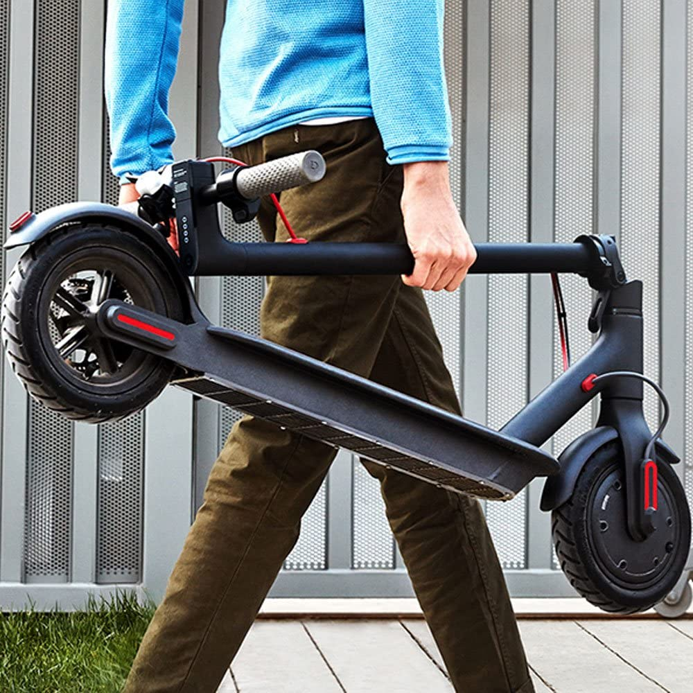 person carrying Xiaomi Mi Electric Scooter
