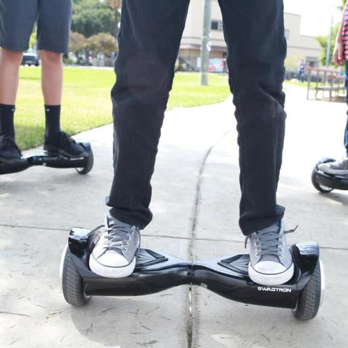 Swagtron T5 in use on a pavement