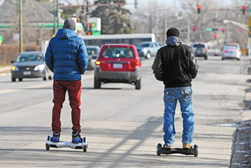two men riding hoverboard