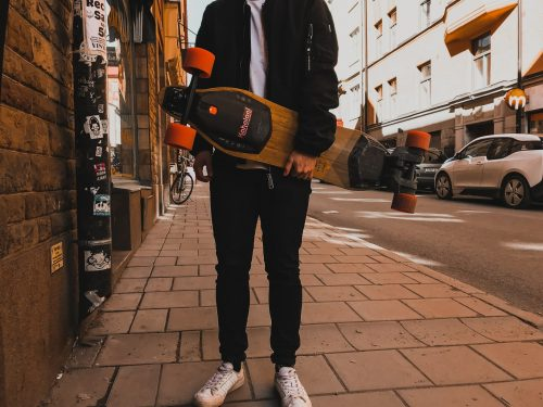 electric skateboard held by rider