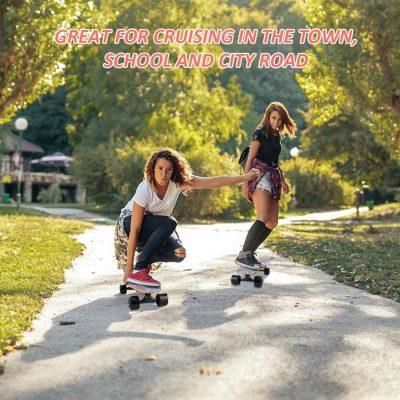 girls riding skateboard