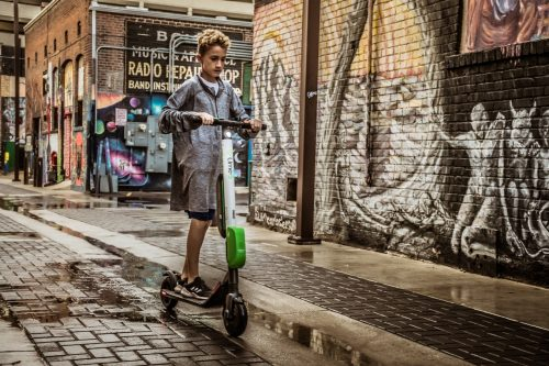 kid on electric scooter